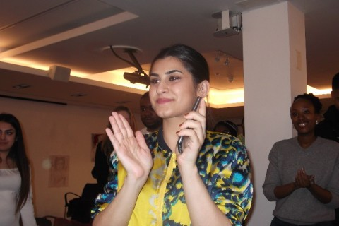 Evar Hussayni applauds her students
